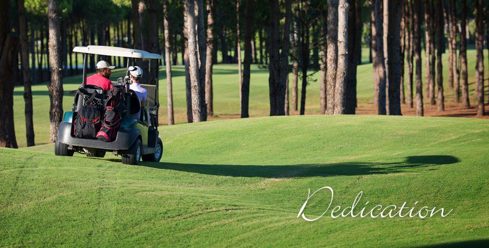 two men on a golf course riding a golf cart Woodside-Aiken Realty real estate agency Aiken SC